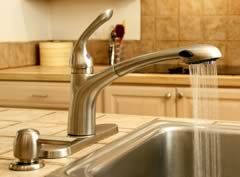 modern kitchen sink with spray tap