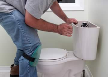 Plumber working on WC